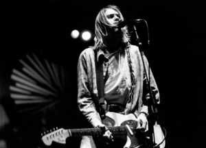 ITALY - FEBRUARY 21:  Photo of Kurt COBAIN and NIRVANA; Kurt Cobain performing live onstage at Palasport, Modena, playing Fender Mustang guitar  (Photo by Raffaella Cavalieri/Redferns)